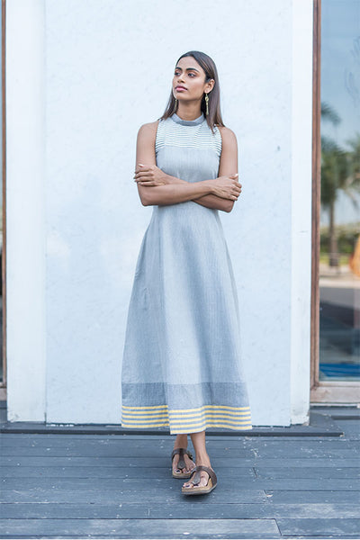 Grey haulter neck long dress.