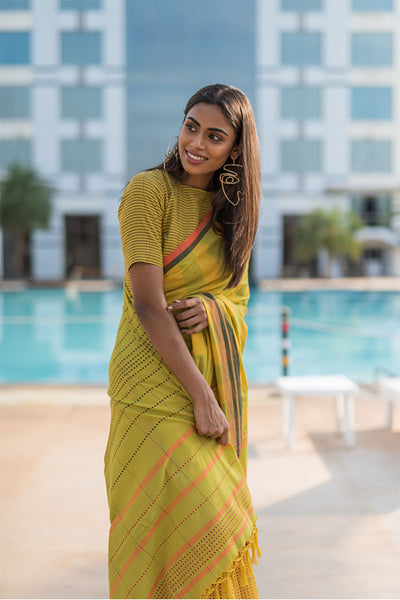Turmeric yellow saree with chilli flakes and peppercorn dots. - noolbyhand.com