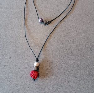 Long red resin carved coral necklace