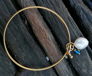 Golden pearl bangle bracelet with evil eye charms
