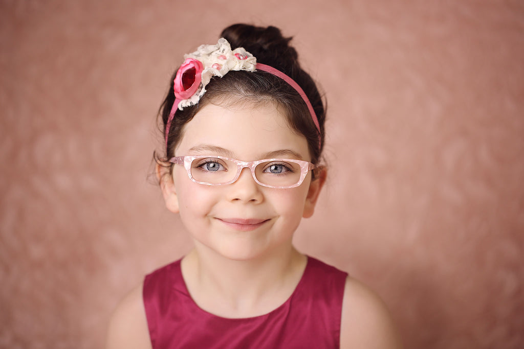 Beautiful girl's glasses in pearly pink colour