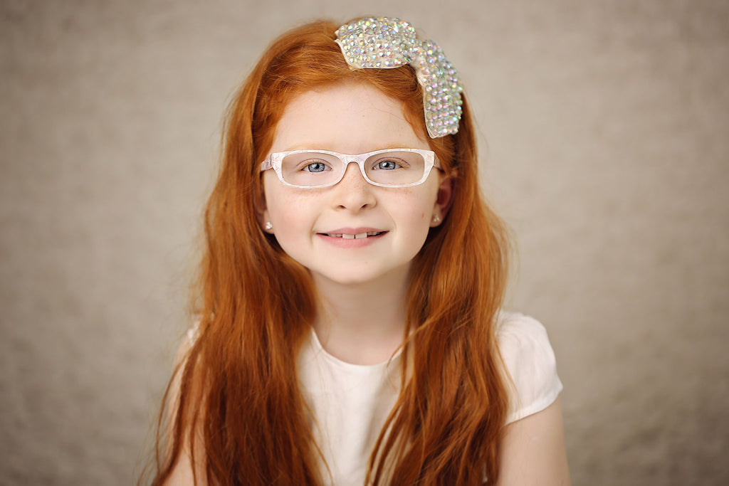 White pearly glasses for first holy communion