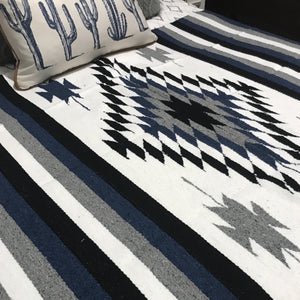Authentic Falsa blanket with beautiful Chevron pattern and contemporary hues of white, black, navy and grey. Fringed ends.  These Southwest style blankets can be used many ways in your home. Lay on the bed, couch, patio setting, weekend adventure or just to curl up with.   Made in Mexico, are soft medium weight cotton blend but not heavy like wool. They make a nice bed topper over your doona and great for wrapping up on a chilly night for that extra layer.