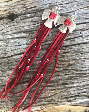 Roxy West leathers collection. Handcrafted genuine accessories designed to flatter your features and enhance your style ... you'll never want to take them off. 〰️ Artisan-made earrings in beautifully soft 'velvet red' deerskin leather with a pair of platinum silver Thunderbird Conchos, knotted with dramatically long laced leather fringe and silver accents.  Pendant with 3.5cm and overall earring length 20cm .925 Sterling silver hardware. Custom made by Roxy @roxywestau 🇦🇺 RRP $79