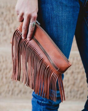 The Dallas Clutch - a beautiful leather fringe clutch that packs western punch! It's perfect to carry your essentials in style. Compact and stylish, made for those that wish to carry light.