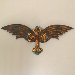 Bring some Western charm to your home or patio wall with this Fleur Di Lis wall cross with wings.  Metal. Distressed dark bronze with painted accents of turquoise, red and gold.