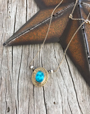 "Nevada Turquoise 〰️ Exquisite 100% natural Nevada Blue Moon mine Turquoise set in .925 sterling silver pendant. Bead/Pendant size 1.5"".  Stone size 11x13mm. Strung on a sterling silver chain with White Buffalo Turquoise and Navajo pearl accent on either side. 17"". Handcrafted by silver makers in New Mexico"