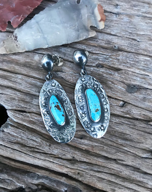 "The Stones. Gorgeous natural sky blue Kingman mined Turquoise. Hand cut stone size 8x10mm.  Style: set in decorative southwestern style .925 sterling silver hand stamped earrings! 2"" in length overall with vintage sterling clasps. Handmade in the heart of New Mexico"