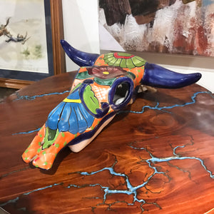 Mexican Art. New arrival.   Add some pop to your western or southwest decor with this hand-painted Mexican cowskull.  Display it on your wall, table top or floor.  Each one is unique and an original. Handcrafted by Artisans in Mexico. Size approx: 30 x 30 x 12cm.