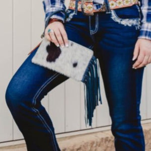 beautifully artisan-made clutch that packs cowhide punch! It's the perfect size to carry your 'on the go' essentials in style.  Roxy West Collection Be unique, be an original