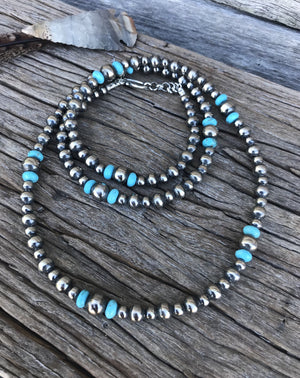 "These are genuine Navajo Pearls, handmade by artists who have been making these pearls for generations. Each Pearl bead is plated in .925 sterling silver, antiqued & polished creating a shimmering, perfect Navajo pearl!  This gorgeous design is the full 34"" length with 6mm 8mm and 10mm Navajo Pearls with Turquoise bead accents and clasp in silver."