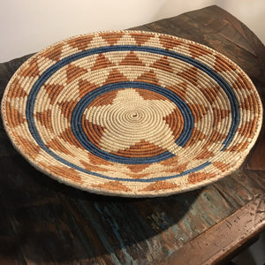 Southwest Charm  Stunning and colourful handwoven tribal baskets with intricate southwest patterns.  They have many purposes in your home, as serving baskets for breads, table centre piece or beautiful home decor displayed on the wall, shelf and buffet setting.