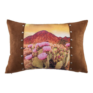 "Modern Southwest Furnishings    Stunningly realistic printed desert landscape on faux suede, this pillow is accented with buckskin faux suede ends and rounded silver studs. A lovely addition to any room.  Measures 18"" X 12"". Studs are embedded into the fabric for durability, not glued. Hidden zipper closure. Spot clean recommended. Shell: 100% polyester, filling: 100% waterfowl feathers. Imported."