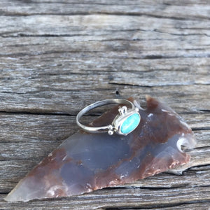 The Stone: A natural Royston Turquoise gem with a full matrix of azure blue and natural accents.  The Ring: Dainty oval shape in .925 silver, Southwest detail and simple silver band. Artisan crafted in Australia using quality USA/Arizona Turquoise. 'One of a kind'. Easy to wear.