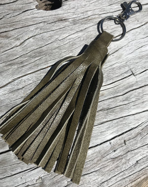 Western tassel with clip.   Artsian made leather tassel crafted from gorgeous genuine leather. Clip one of these baby's on to your favourite bag, car keys or outfit for Cowgirl Cred! ❤️