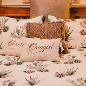 "This country linen style, decorative cushion spells ""Cowgirl"" in chocolate script and is printed on neutral linen fabric.   We imported these beautiful feather filled cushions all the way from Dallas TX. You will find these designs styled in Luxury ranches, Cowgirl magazines and the best Western boutiques.  Stunning when incorporated into several of western bedding collections, or as a focal point on your favorite sofa. Pair with the ""Cowboy"" cushion for the perfect set. Sold seperately."