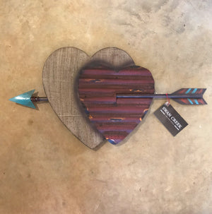 "Add some Southwest spice to you home, patio or outdoor area with this Double Heart & Arrow wall art.  Ready to hang on a nail or hook.  24"" Rustic look. Metal and painted polyresin. Size (Inches): 12 X 23 Imported Dallas Tx."