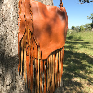 The Lakoda, a modern-cowgirl style handbag. It has the signature natural leather flap and fringing. The signature size handbag to carry your 'everyday' essentials in style. It's not to big and not to small..it's just right!  Roxy West Collection
