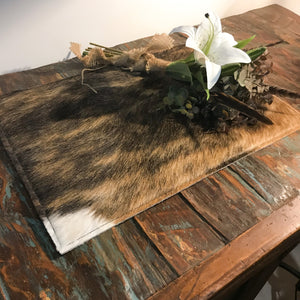 <p>Beautiful as a table centre piece, on that bar setting or under your favourite lamp.<br></p> <p>Genuine 'longhorn hide' with natural split leather backing. Sourced by us from Dallas TX. </p>