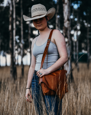 A beautiful leather handbag for everyday use, that's big enough to carry your life's essentials in style.  Roxy West Collection. Western inspired design, expertly handcrafted by our leather artisan makers in genuine Italian leather.