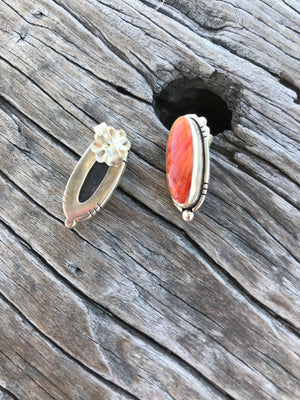 "Then stones: Show Stoppers! Beautiful natural light red/ orange Spiny Oyster with natural matrix from the coast of Baja. Shell size oval 20x8mm. Highly polished genuine beauties.  The setting: Artisan made in pure .925 sterling silver with Southwest style accents! Overall earring length, just shy of 1""."