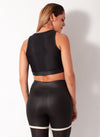 Black and Nude mesh top sports bra back view on model