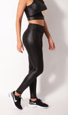 Liquid black leather-look legging side view on model