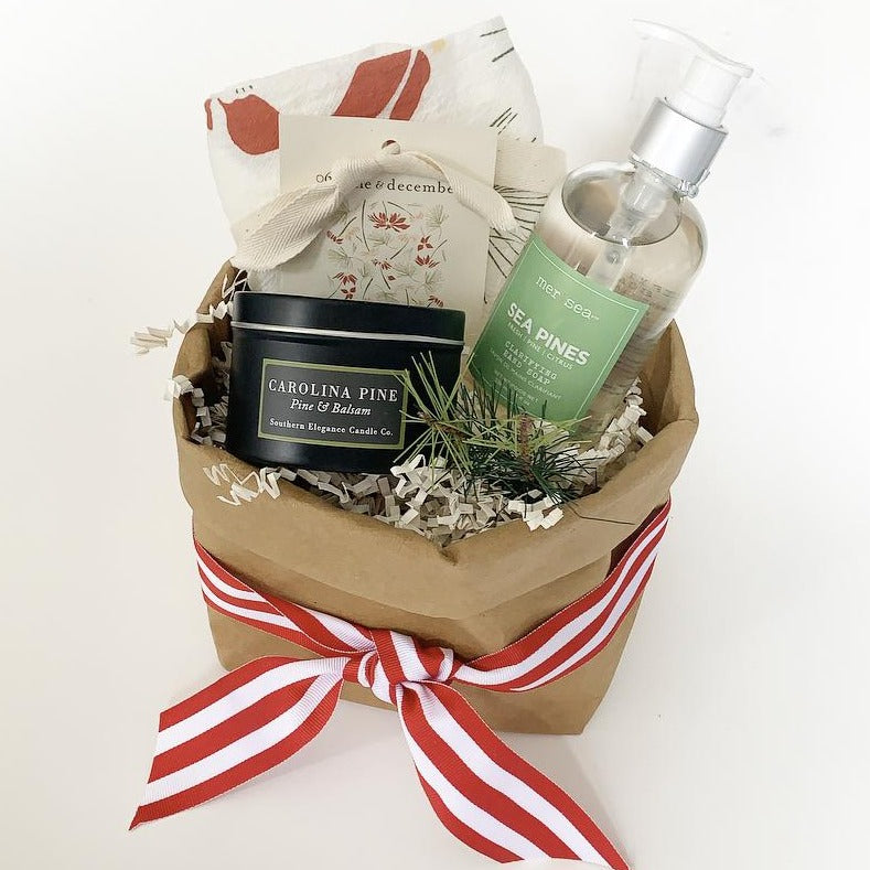 Included in this assortment are a Carolina Pine travel tin candle, Sea Pine liquid hand soap and an organic cotton Christmas hand towel. Great gift for teachers, clients, moms. Small Batch Gallery in New Bern NC