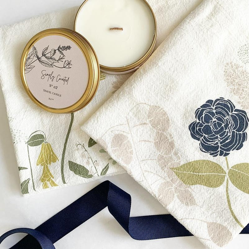 Simply Curated travel candle packaged with June and December Peace & Happiness flour sack towels. New Bern NC