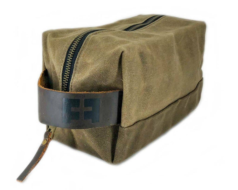 Heavyweight waxed canvas dopp kit with leather handle, great for his travels. Small Batch New Bern NC