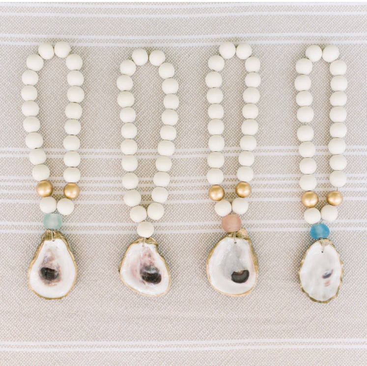 Adorn a room, shelf, doorknob, or table with coastal gratitude with the Oyster Blessing Beads.
