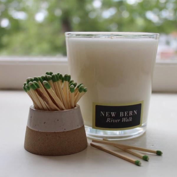 the River Walk candle is an exotic bouquet of our pink magnolia blossom is naturally sweet and satisfyingly bold. Travel candle & Tumbler. Available at small batch graphics + goods in New Bern, NC.