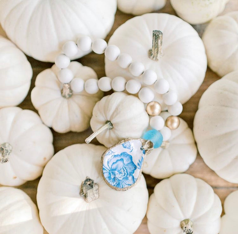 Petite Blessing Beads with hand painted oyster shell available at Small Batch Gallery New Bern NC.