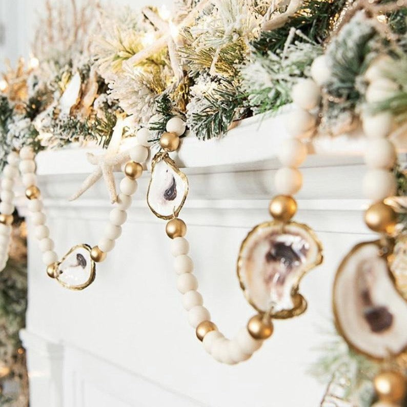 This unique garland, made of hand painted oyster shells and wooden beads, will add a coastal flare to your holiday decor. Grit & Grace, available at small batch new bern nc.