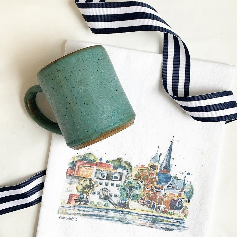 New bern skyline towel and handmade mug available at Small Batch Gallery New Bern NC