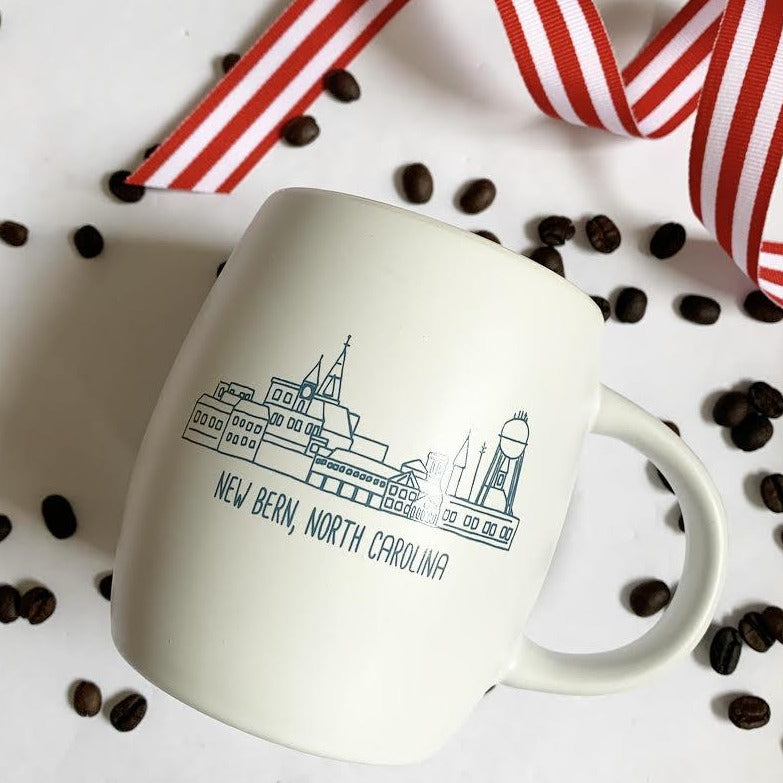 White mug adorned with our exclusive New Bern skyline drawing