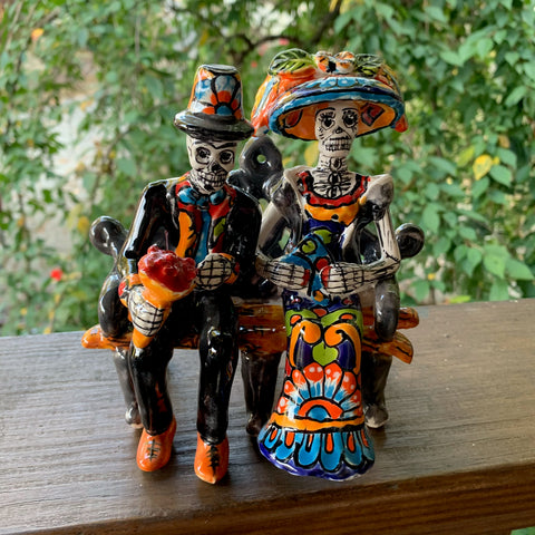 catrina couple on a bench