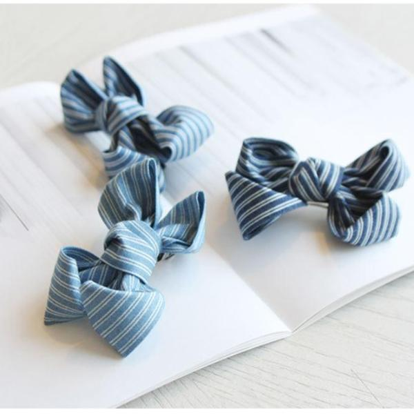pretty denim bow for toddler girls, stripe print and attached to alligator clip