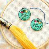 Life's a stitch Magnetic Needle Minder | Sarcastic Cross Stitch or Embroidery Hoop Hard Enamel Needleminder | Teal w/ Bobbins Needle Holder