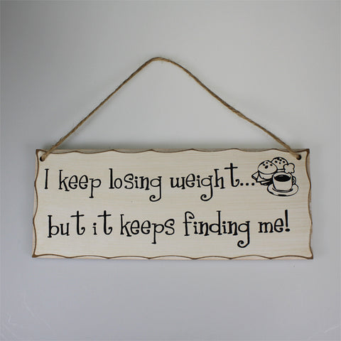 'Losing Weight' Plaque Sign