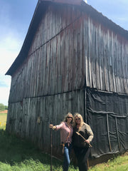 founders of hemp essentials standing next to a barn