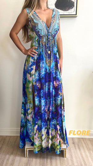 Color: Flore Shahida Parides Plunge Dress, Dark blue, light blue, and green floral pattern with beading on neckline