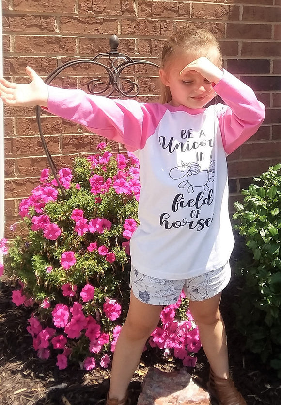 Be A Unicorn in a Field of Horses Girls Raglan