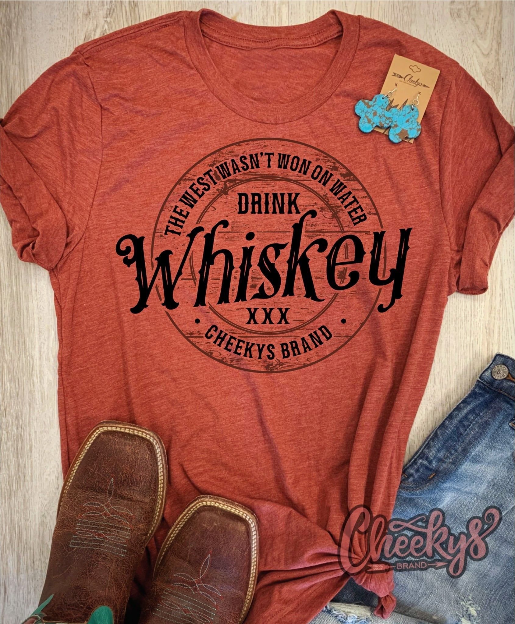 "Cheekys ""The West Wasnt Won On Water Drink Whiskey"" Unisex T Shirt"