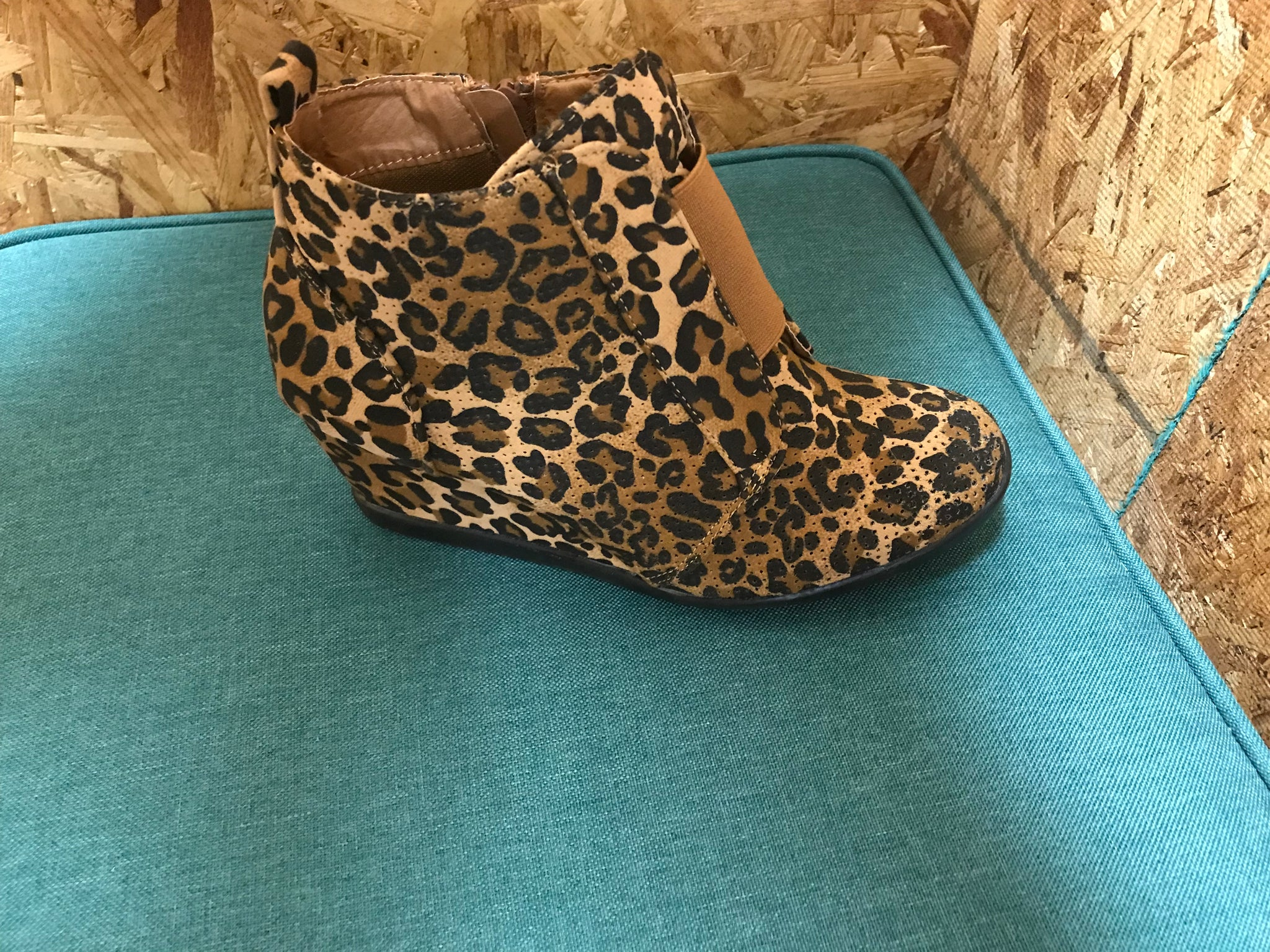 Leopard Wedge Shoe Has elastic strap across the top