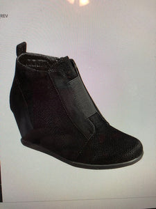 Black Wedge Shoe Has elastic strap across the top