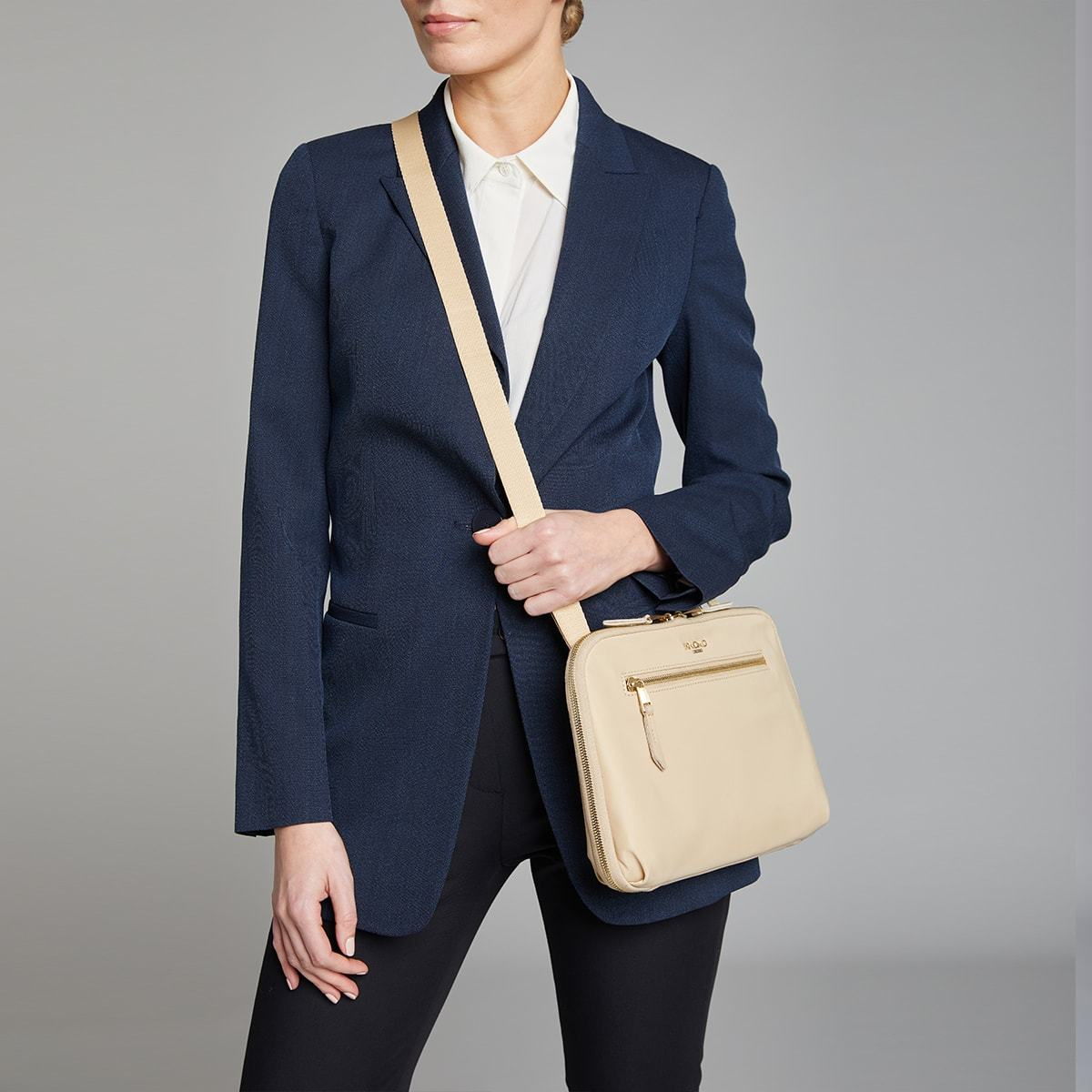 "KNOMO Knomad X-Body Organiser Tech Organiser Female Model Wearing 10.5"" -  Trench Beige 
