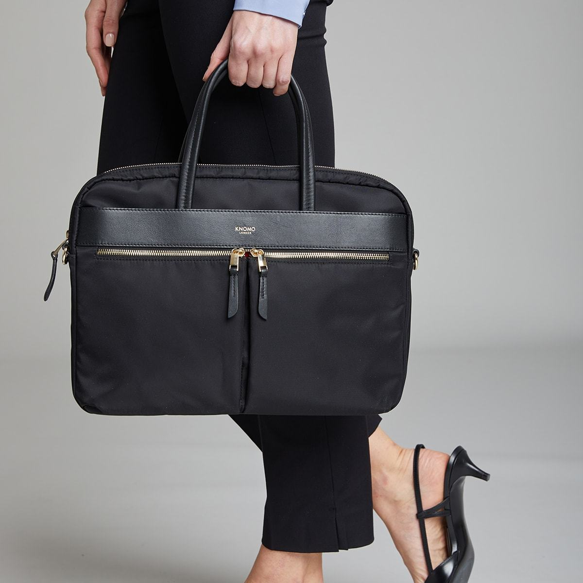 "KNOMO Hanover Laptop Briefcase Female Model Holding By Straps 14"" -  Black 