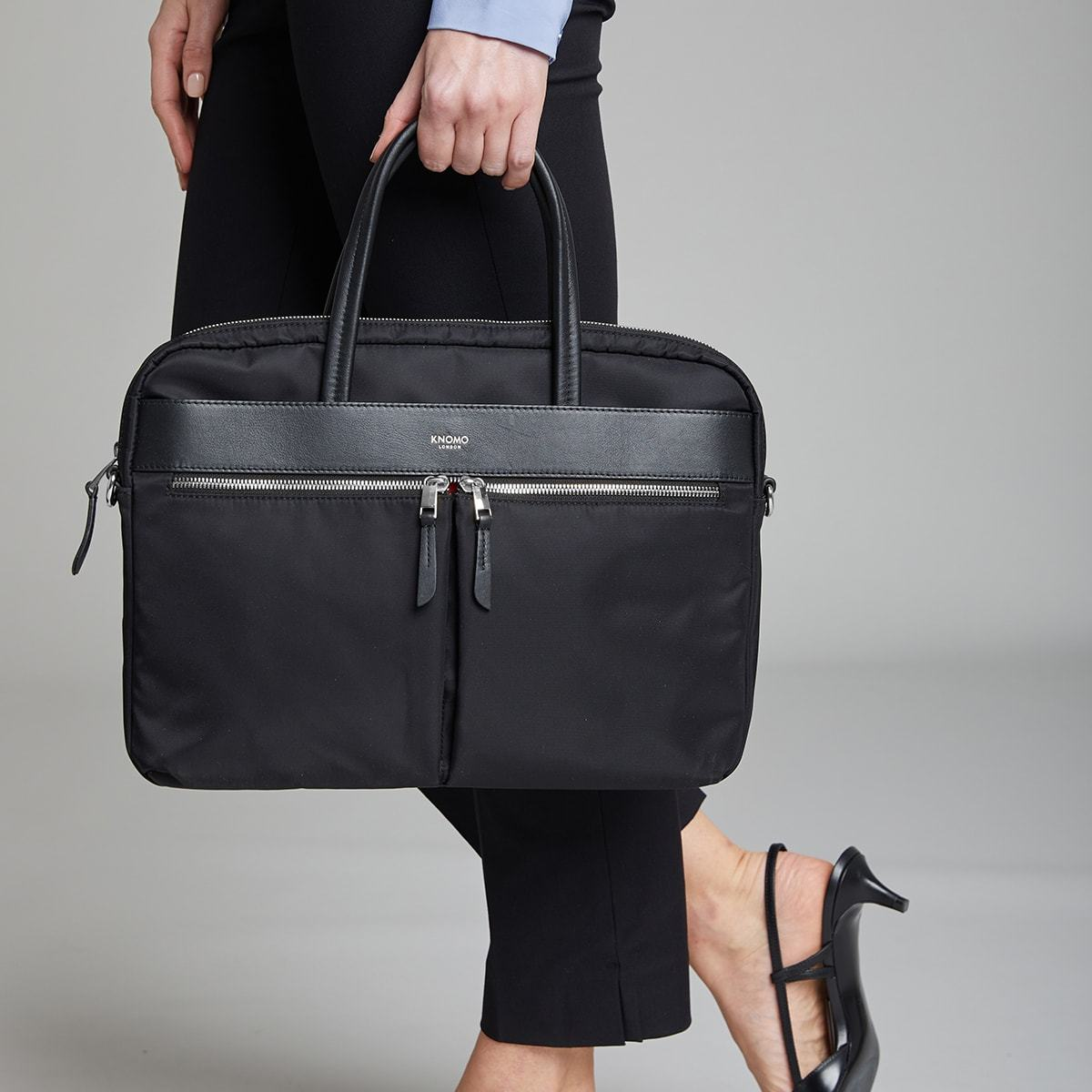 "KNOMO Hanover Laptop Briefcase Female Model Holding From Straps 14"" -  Black 