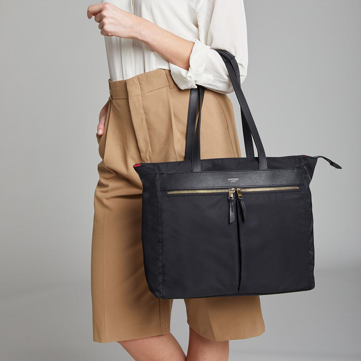 "KNOMO Grosvenor Place Tote Female Model Holding Straps 14"" -  Black 